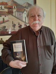 Picture of Professor Ward with copy of new edition of Roque Moreno