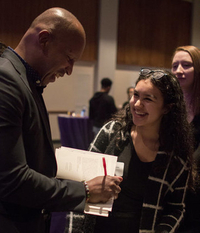 Bryan Stevenson signs a copy of his book 'Just Mercy' for Loyola students