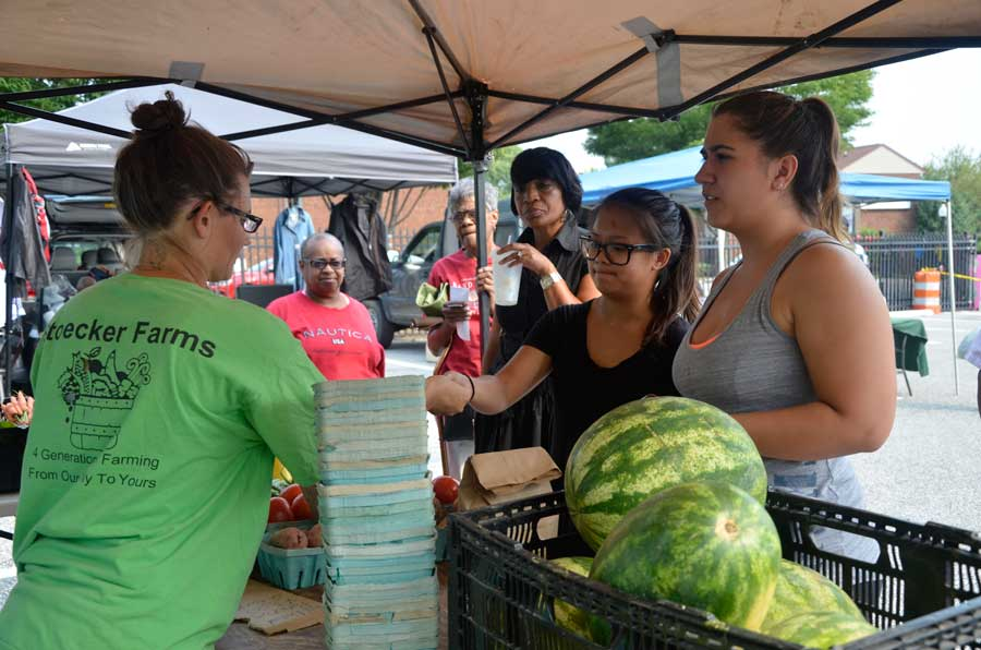 students at farmers market