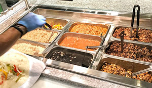 Serving counter with burrito fixings