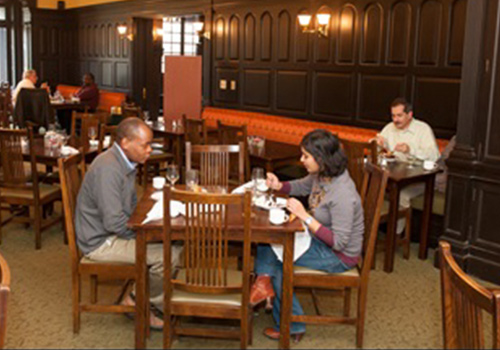 Employees eating in the Refectory