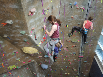 Student climbing at the climbing wall