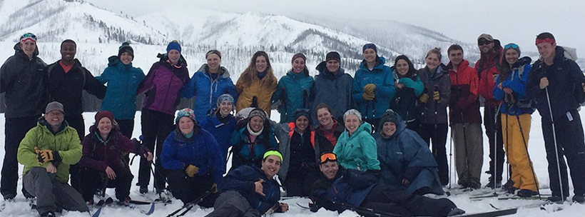 Outdoor Adventure Experience participants on top of snowy mountain