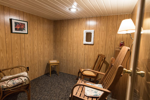 Confessional room with three rocking chairs