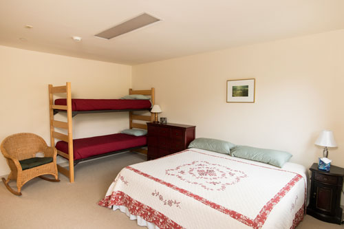 View of buttercup room with full bedroom and bunk bed