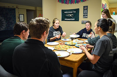 Students sharing a meal together in a McAuley residence