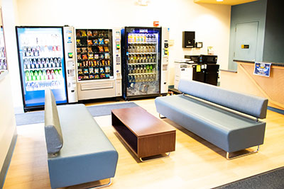 Butler Hall lounge with couches and vending machines