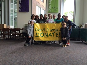 good stuff student employees holding a dont dump, donate sign