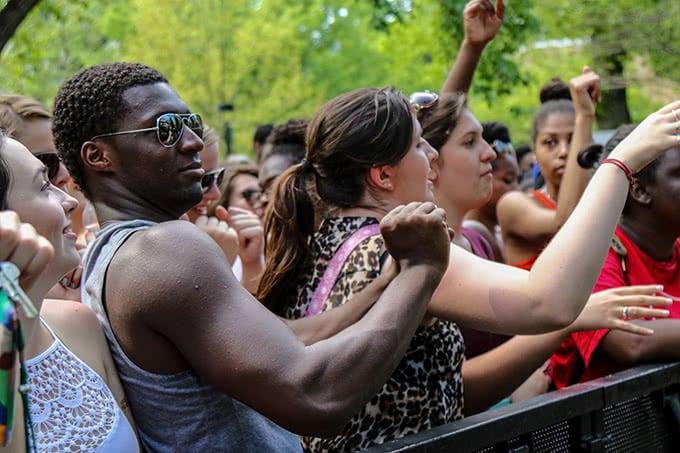 Student raising arm and dancing at Loyolapalooza