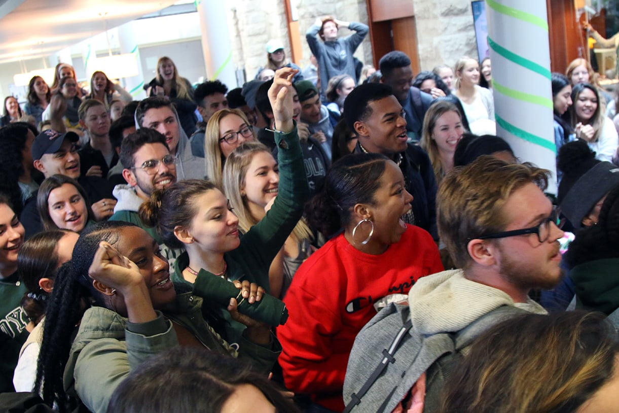 A large group of students cheering at a prep rally