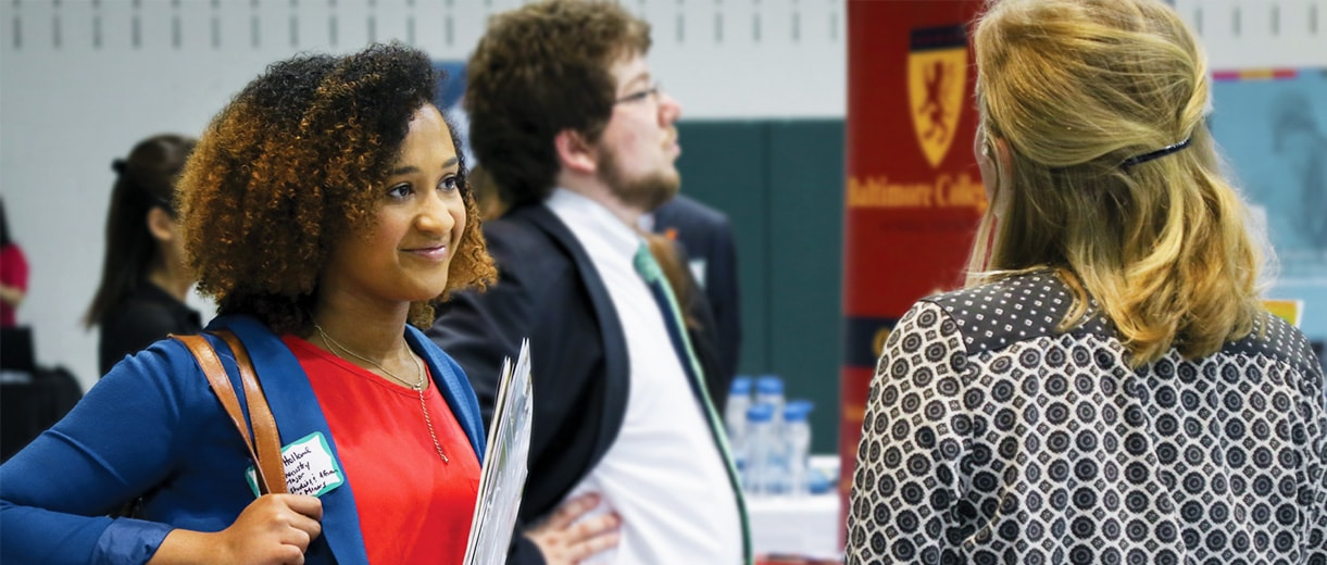 Loyola student at a career fair