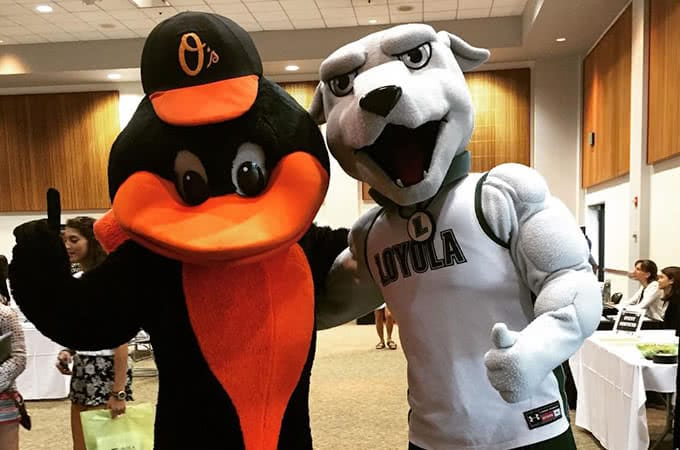 The Baltimore Orioles and Loyola Greyhounds mascotts posing together