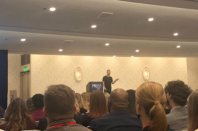 Speaker Will Collie on stage at the PRSSA International Conference in San Diego