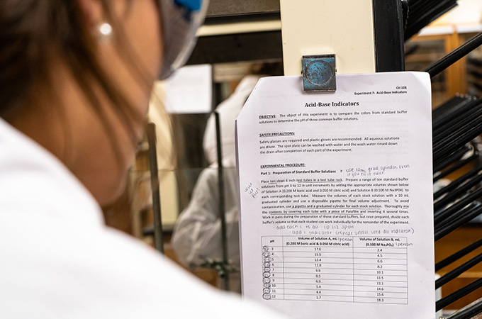 A student reads the assigned lab report.