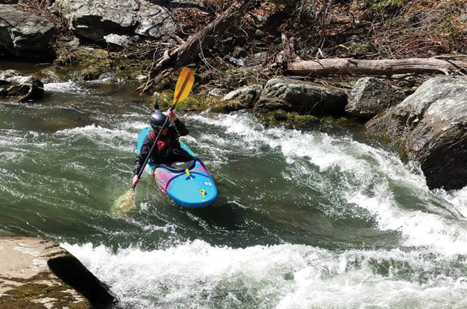 Paddler prepares to enter whitewater.