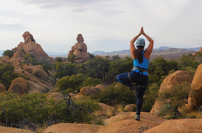 Morning yoga in front of a rocky landscape.