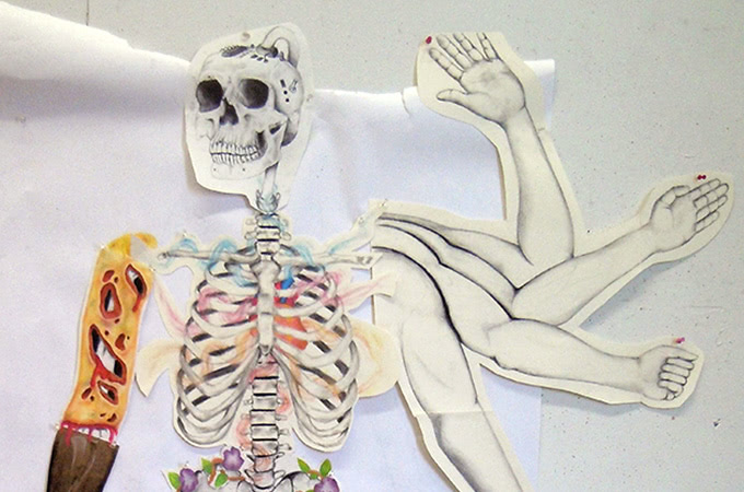 Cut-out drawings of human bones and arms that have been glued together to form a new image