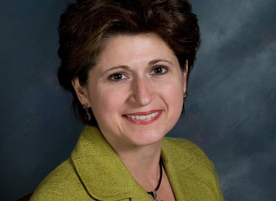 Mary Cina Chalawsky, '84 smiles in her professional portrait.