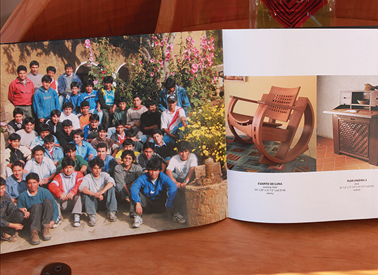 Photo of the artisan team and their furniture pieces in product book.