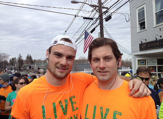 Brian De Sena and Dan Sweeney at the race wearing orange shirts.
