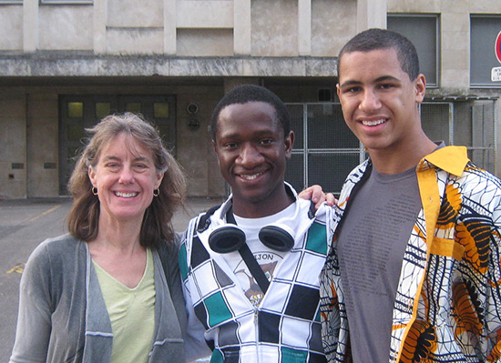 Elizabeth in photo with two students.