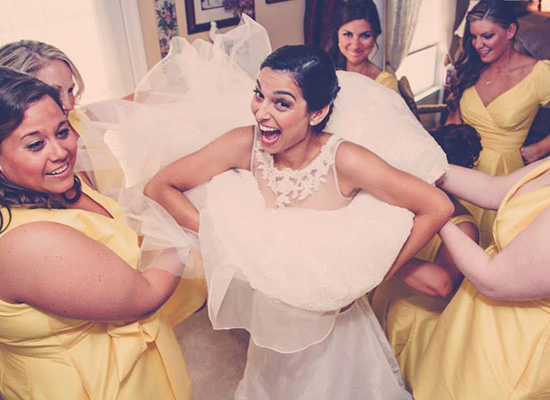 Bride surrounded by her bridesmaids.