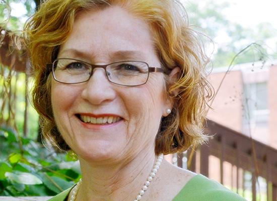 Photo of Christine Manlove smiling.