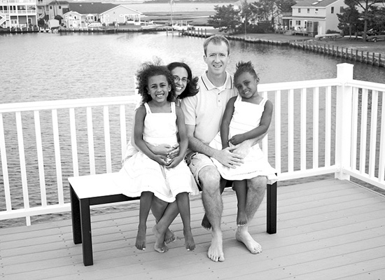 Radday family sits together on their porch pier.