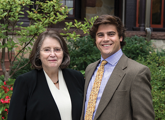 lona McGuiness, Ph.D., with Chris Miller, '15, standing together near the humanities manor.