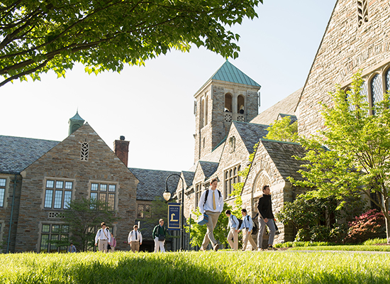 Loyola Blakefield's campus, illuminated by the sun as students walk through.