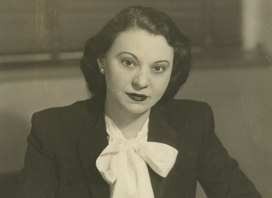 Antique photo of Bessie in professional clothing.