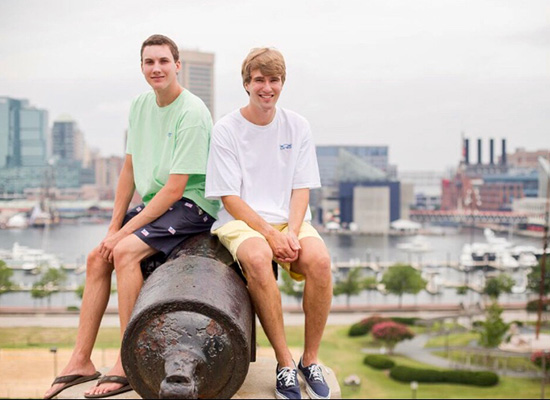 Wilmer and Ames sitting on an old cannon at Federal Hill, overlooking Baltimore.