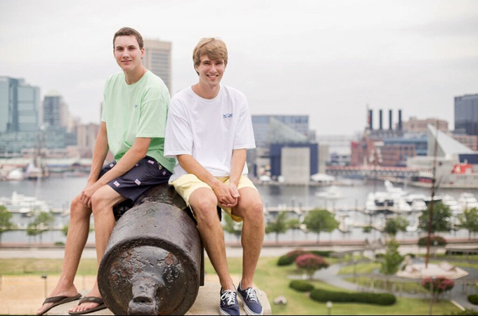 Matt and Kevin sit on a cannon at Federal Hill.