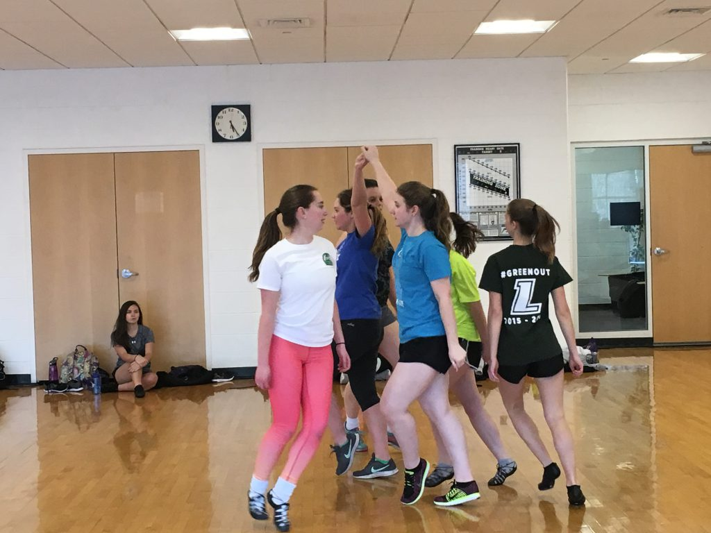 Students in a circle practicing Irish dancing