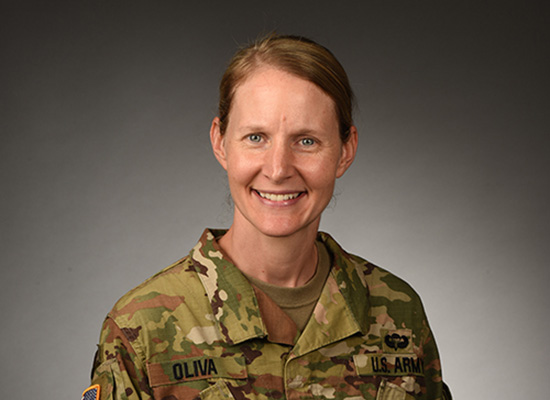 Lt. Col. Ammilee A. Oliva smiles, wearing her Army uniform in official portrait.