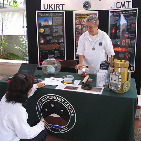Inge Heyer at a booth conducting astronomy community outreach at Onizuka Day in Hilo, Hawaii in 2009.