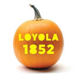Pumpkin with Loyola 1852 carved in it