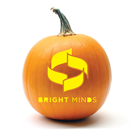Pumpkin with the Bright Minds campaign logo carved in it