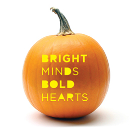 Pumpkin with Bright Minds, Bold Hearts carved in it