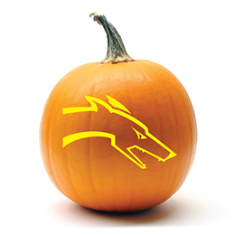 Pumpkin with a greyhound head carved in it
