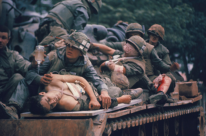 Injured soldiers transported on a tank in Vietnam