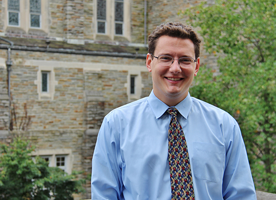 Photo of JP in dress shirt and tie outside the alumni chapel.