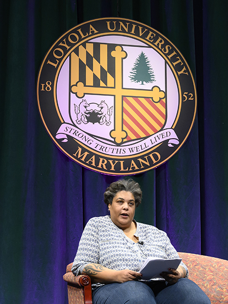 Roxane Gay seated on Loyola's stage.