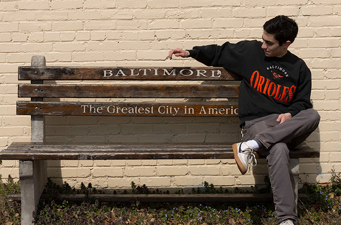 Andrew sitting on a Baltimore bench