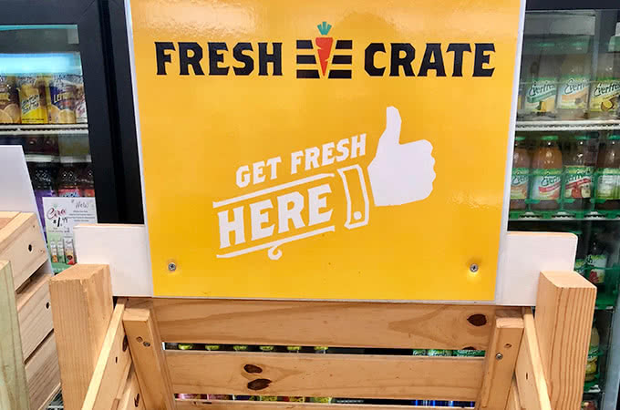 A sign that reads Fresh Crate - Get Fresh Here
