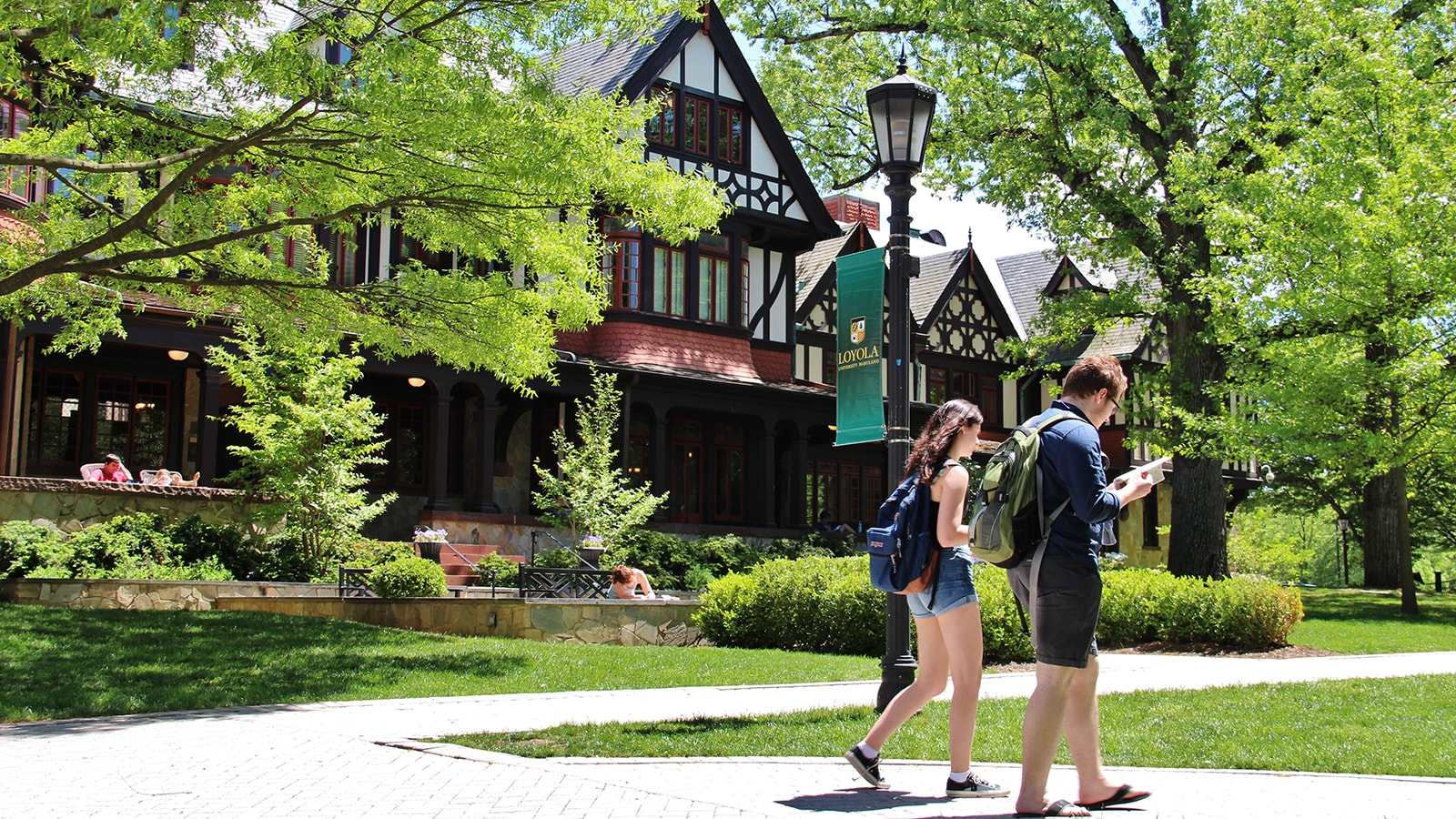 Two students walking in front of the Humanities Center on Loyola's Evergreen campus