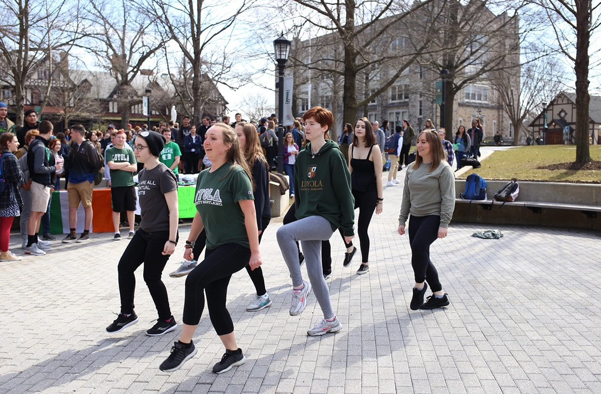 Group of students practicing a dance for Loyola's Irish step dance team