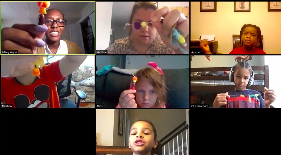 Screenshot of children working on arts and crafts projects on a Zoom conference