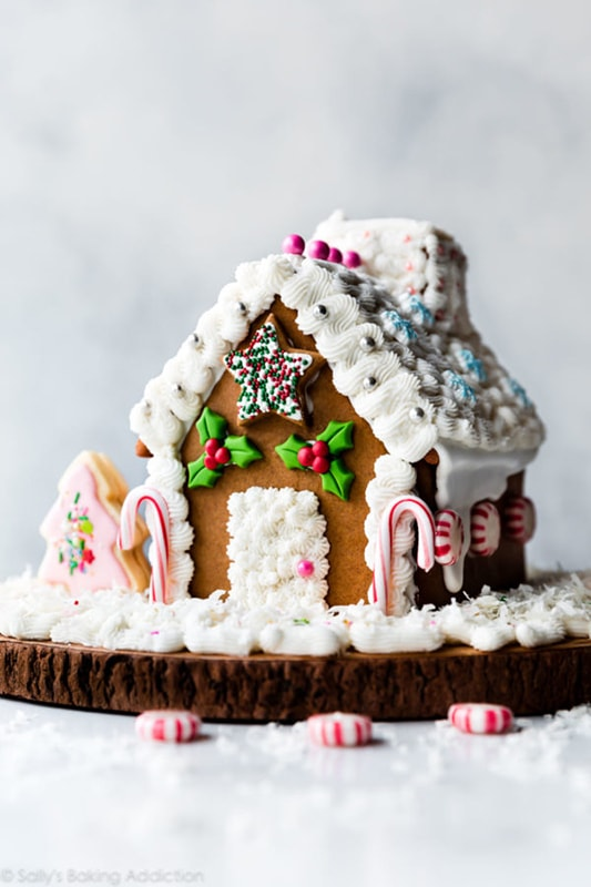 Gingerbread house decorated with various candies and icing