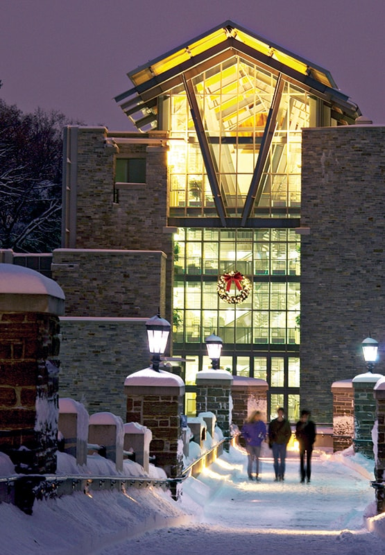 Exterior of the Sellinger School of Business decorated for Christmas